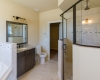 This bathroom has a European-style walk in tiled shower, as well as a jetted whirlpool tub. New homes have updated features, while old homes require upgrades.