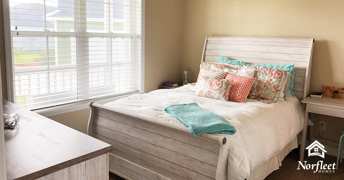 Pictured here is a bedroom in a Norfleet home. Norfleet builds luxury custom homes in Newberry, High Springs, and Gainesville, Florida.